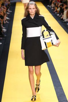 Spring 2015 Ready-to-Wear - Carven -- Black short coat with white block stripe waist and shoulder detail.