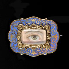Brooch in rolled gold with enamel decorationsMiniature lovers eye handpainted on ivoryGeorgian, ca. 1820, England In the 18th and early 19th century lovers gave each other jewels...