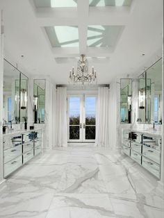 Master Bathroom With Marble Floor Mirrored Cabinets And Drawers Crystal Chandelier French Doors