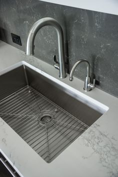 The kitchen sink features polished quartz countertops and a modern faucet.