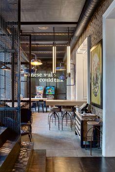 Dogs & Tails Bar and Café by Sergey Makhno Architects, Kiev, Ukraine - Retailand Bar Design Cafe Bar, Cafe Restaurant, Restaurant Design, Corner Restaurant, Commercial Design, Commercial Interiors, Cafe Seating, Coffee Shop Design, Bar Interior