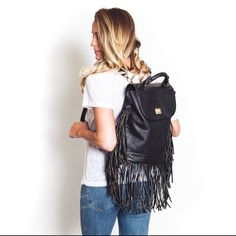 Faux leather fringe black gold hardware back pack Open to offers! Gorgeous faux leather black fringe backpack with gold hardware. Brand new never used. Long hanging tassel fringe detail with handle on top that makes it easy to carry or hang up. Twist buckle closure. Straps are removable if desired. Multiple available. !!Please do not purchase this listing! Ask me to make you a separate one! Bags Backpacks
