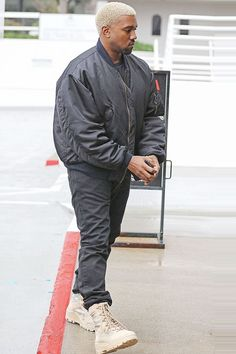Kanye West wearing  Adidas Combat Boot Light Sand, Raf Simons Bomber Jacket