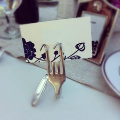 another diy option with dollarstore or goodwill silverware Ruffled® | See ads - Vintage Silver Fork Place Card Holder - Reception