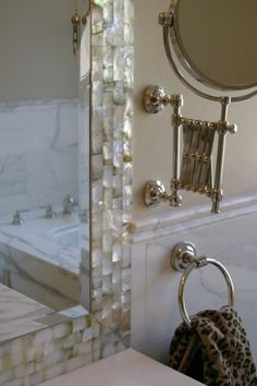 Gorgeous bathroom mirror framed with Mother of Pearl tiles. Found at https://www.subwaytileoutlet.com/