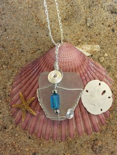 #548 Turquoise bead on clear seaglass