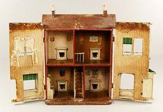 Lines dollhouse interior listed as American Folk Art Handmade Doll House - by Kaminski Auctions