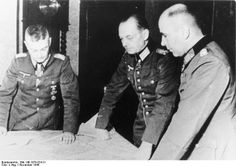 The German general who became planner Unternehmen Wacht am Rhein, photographed November 1944 a month before the operation was launched. From left to right: Generalfeldmarschall Walter Model (Commander Heeresgruppe B), Generalfeldmarschall Gerd von Rundstedt (Commander of the German forces on the Western Front), and General der Infanterie Hans Krebs (Chief of Staff Heeresgruppe B)