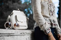 woman wearing beige and red floral top leaning on gray concrete slab with white leather bag ontop photo – Free Fashion Image on Unsplash Fashion Blogger Style, Fashion Brands, Fashion Tips, Fashion Design, Fashion Bloggers, Fashion Hacks, Fashion 2018, Fashion Fashion, Fashion Ideas