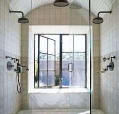 double shower with a great window - love the curve via ken linsteadt architects