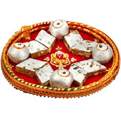 Rakhi Dil Bahaar Decorative and traditional cane thaali covered with red raw silk fabric, embelished with auspicious mauli thread, swaroski stones, and Ganesha to bless your loving brother with your choices wishes. This thaali contains: Kaju mewa katli - Kaju sweets prepared with kaju and pista chunks. Net weight: 150 grams. Kaju lemon. Net weight: 100 grams. Comes with rakhi, lumba, roli and chawal. Rs 739/- http://www.tajonline.com/rakhi-gifts/product/r4527/rakhi-dil-bahaar/?aff=pint2014/