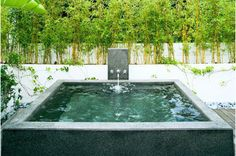 Make use of small, efficient water elements. A spa is a great place for decompressing and letting off some steam after a long day. In our hot summer months, a hot tub can also double as a cool plunge pool.     I also love to add a soothing, built-in fountain to a plunge pool. Smaller fountains and water features can help muffle out the sounds of the city and drown out the stresses of the day.