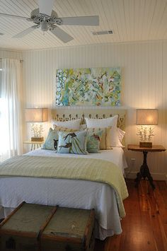 Beach cottage bedroom with floor to ceiling painted wood paneling. *Wood look awesome in muted sea tones rather than stark white*