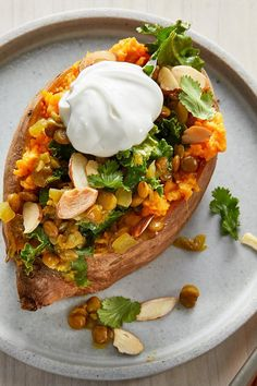 Flavor-packed, incredibly nutritious, and very filling, this stuffed sweet potato is a triple threat! You'll get nearly 50 percent of you. Vegan Recipes At Home, Easy Home Recipes, Heart Healthy Recipes, Delicious Vegan Recipes, Healthy Foods, Vegetarian Entrees, Vegetarian Cooking, Vegan Food, Vegetarian Casserole