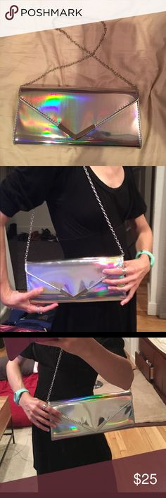 "Holographic Rainbow 🌈 Aldo Clutch This purse is sooooo cool and I wish I could keep it but it just doesn't fit all the things I'm used to carrying around. Really trying to give lots of pics that'll give you a clear picture of the size. 11"" long and 5"" tall, and about 1.5"" thick. Chain is 30"" (that's about 14"" long from top of shoulder to top of clutch). Only worn out once. I love the 🌈 effects, I'm just too used to my big wallet/keys/phone to use it often as it deserves. Aldo Bags Clutches…"