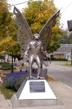 "A metallic statue of the Mothman created by artist and sculptor Bob Roach, Point Pleasant, West Virginia. Represents the mysterious creature called the ""Mothman"" people have claimed to have seen over the years Weird Creatures, Mythical Creatures, Mythological Creatures, Paranormal, Point Pleasant West Virginia, Virginia Occidental, Mothman, Ohio River, Roadside Attractions"