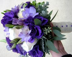 Bridal Bouquet with cream import roses and white freesia and lisianthus