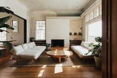 wooden floors, white walls, mid-century design, neutral