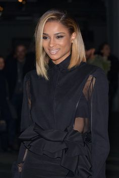 Ciara The striking contrast of blond tips and dark roots adds an edgy element to Ciara's midlength haircut.