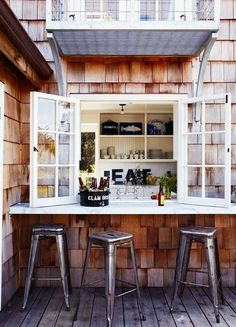love the idea of the kitchen window opening to a bar setup outside!