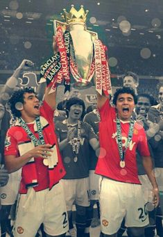 Rafael and Fabio Da Silva holding the trophy!Glory Glory Manchester United!