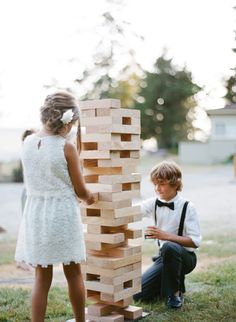 Giant Jenga for the kids (and adults): http://www.stylemepretty.com/living/2015/05/18/14-outdoor-party-games-for-your-next-spring-bash/