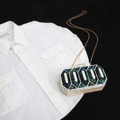 Shirt: Martin Margiela circle collection  Clutch bag: Lolita Lorenzo