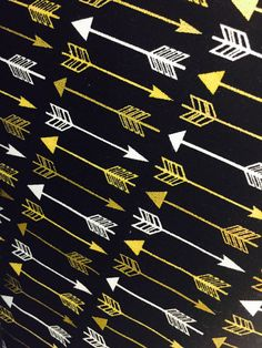 This gold & black arrow print fabric is perfect for any craft! The arrows are bidirectional and measure just over an inch making it perfect for