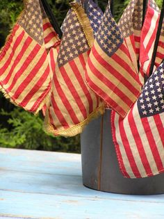 flag collection in painted tin pail