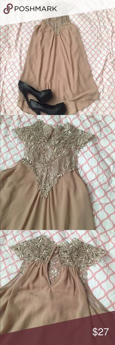 Nude dress with lace detail Lace neck detail with two clasps in the back. Sheer nude dress with lining. This dress is beautiful! Slightly high low length. Dresses Mini