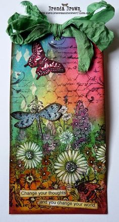 "Lovely Tag by Brenda Brown uses ""A Garden of Flowers"" stamp, distress inks, and paints."