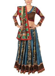 This authentic hand painted kalamkari lehenga set by Yosshita & Neha exemplifies elegance. The classic lehenga features alternate kalis in steel blue pure raw silk and hand painted kalamkari in peacock motif. The look of the lehenga is enhanced by brocade blouse with lord Durga motif in kalamkari at the back yoke and golden aari embroidery on sleeves. The deep red and green embroidered dupatta complements the lehenga beautifully.