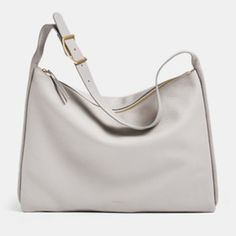 The Anesa shoulder bag is structured and sizable enough to carry a laptop but takes on a draped shape when toting smaller items. The zip closure opens to reveal two slip pockets, one zip pocket, a penholder and an earbud holder. Leather Shoulder Bag, Shoulder Strap, Woman Silhouette, Skagen, Womens Purses, Purses And Bags, Accessories, Laptop, Closure