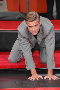 George Clooney At His Hand And Footprint Ceremony At Grauman's Chinese Theater.