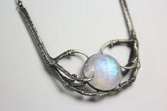 Nyx necklace: cast sparrow hawk claws & moonstone necklace.