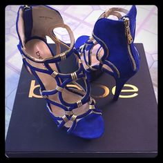 Blue and Gold BeBe High heels These are wonderful heels and size US 8 and I wore them once. I honesty wish I had places to go with These, unfortunately I don't. They come with its original box. And are the best deal ever. I'll be sad to see them go but I hope whoever gets them will love them as much as I did ☺️ comment with any questions. Thank you! bebe Shoes Heels
