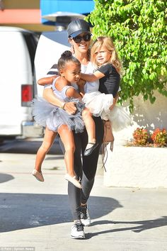 Don't worry sis, I got this! Kourtney Kardashian juggles tiny dances North and Penelope wh...