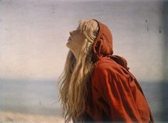 Autochrome lumière photograph made by Mervyn O'Gorman in 1913. He did a series of his daughter Christina at and near Lulworth Cove in Dorset in which she always wears red clothes.