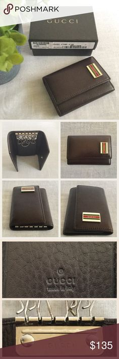 Gucci Card Key Holder NWOT Authentic Gucci Cellarius Leather Key holder.  Brown leather, rectangle plate with with enamel red green stripes and hallmarked Gucci, 6 key rings and a slot for cards.  Serial number is 154493 486430.  Includes the original box.  No trades. Gucci Accessories Key & Card Holders