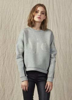 DESCRIPTION The Aje Madden Jumper is a loose fit grey cotton neoprene style featuring the brand logo embossed on the...