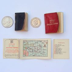 You are viewing two vintage miniature books. The first is the atlas of the british empire, reproduced from the original made for her majesty queen mary's doll's house. Below is a verbatim description from a christie's auction of the same atlas in 2006: atlas of the british empire reproduced from the original made for her majesty queen mary's doll's house. London: edward stanford ltd., [c.1928]. 43 x 34mm. Title printed in red and black, 12 coloured double-page maps. Origin...