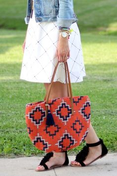 Coral & navy tribal-printed bucket tote with genuine leather shoulder straps and tassel detailing