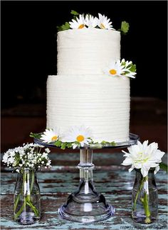 Simple wedding cake - don't have to use daisies, but any other flower/decor...glass plate and jars!