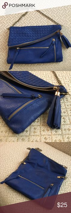 Royal Blue Pleather Crossbody Royal Blue Pleather Crossbody purse with gold metal chain link strap. Decorative woven pattern to exterior. 2 zipper front pockets. Magnetic fold over clasp. Chevron pattern cotton cloth interior liner, has some normal wear on cloth from everyday use. 3 interior pockets. Zipper on interior one pocket is broken. Few small stains on inside of purse shown in images (could possibly be cleaned up). No damage to exterior. Over all good condition besides the few…