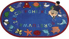 ABC Animals mats -Free Shipping! (free shipping to lower 48 states only) Nothing fancy, just good plain fun with this rug bordered by animals ranging from a blue dog to a yellow cat to a purple penguin. There are lots of places for children to sit during group discussion or story time. Perfect for early childhood.  www.greatmats.com