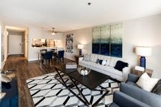 Your living room is very important when it comes to picking out decor. It's where you'll spend a lot of time binge watching TV shows, catching up with friends, or taking a little snooze. This living room at Arrive Alexandria in Virginia is perfectly cozy.