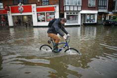 Biker Pedals Through Flood Waters A youth cycles through flood water after the river Thames burst its banks on Feb. 10, 2014 in Datchet, Eng...