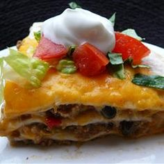 "Burrito Pie | ""Ground beef, refried beans and tomatoes are combined with chiles and taco sauce, then layered in a casserole with tortillas and cheese, and baked."""