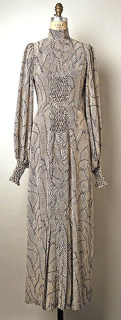 Evening dress Designer: Thea Porter (British, Jerusalem 1927–2000 London) Date: 1970–73 Culture: British Medium: silk Dimensions: Length at CB: 60 1/2 in. (153.7 cm) Credit Line: Gift of Jane Holzer, 1977 Accession Number: 1977.115.6