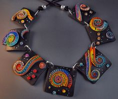 Black Spirals-Polymer Clay Necklace, the contrast between the black tiles and the rainbow colored spirals is fascinating and eye catcing. Polymer Clay Bracelet, Polymer Clay Pendant, Fimo Clay, Polymer Clay Projects, Polymer Clay Creations, Polymer Clay Beads, Clay Design, Bijoux Diy, Biscuit